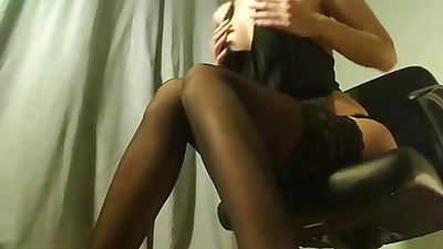 Busty secretary undressing in the office chair
