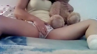Cute babe pushing her pussy into a teddy bear