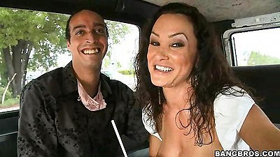 Lisa Ann having a soft drink to wash down the cum