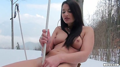 Babe Lana fucks herself with a ski pole