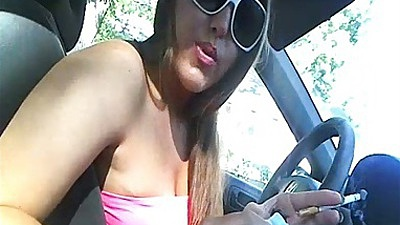 Milf driving around fingering herself in public and showing tits