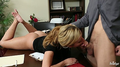 Jessie Rogers gives a blowjob on the office desk