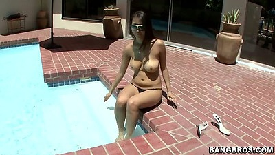 Asian Sharon Lee naked by the pool outdoors