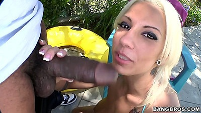 Big black dick blowjob from Lylith Lavey in interracial outdoor sex