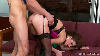 Bent over Jenni Lee takes a cock from behind while wearing her bra