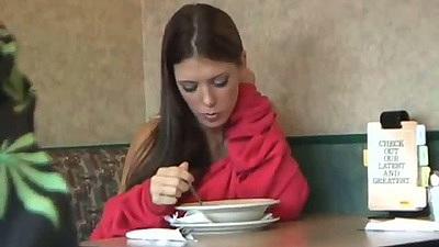 Brunette babe in the diner having a bite