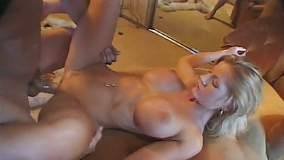 Busty Amber Michaels spreads legs for front penetration and sucking dick