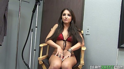 Sexy Giselle Leon sitting solo during interview