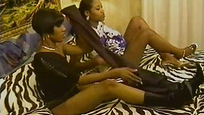 Ebony college student chicks Desire and Erika Vuitton kissing each other